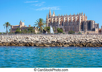Cathedral of Palma de Mallorca, rear view from road. Big...