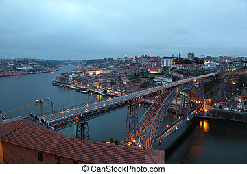 Dom Luis Bridge illuminated at dusk, Oporto Portugal