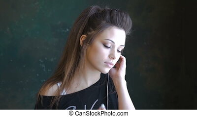 A beautiful young girl dancing to the music. Use headphones. The slow sensual dance