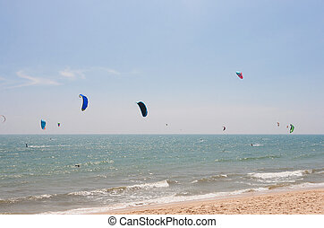 Unidentified people involved in kitesurfing - Kitesurfing in...