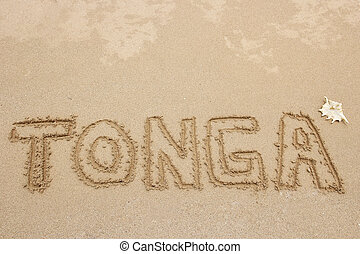 "Word ""Tonga"" written in a sand - travel concept"