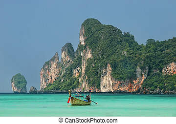 Longtail boat anchored at Ao Loh Dalum on Phi Phi Don...