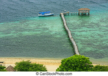 Long wooden jetty at Kanawa Island in Flores Sea, Nusa...