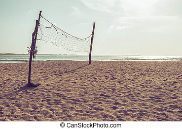 Volleyball net on the beach - Old deserted volleyball net on...