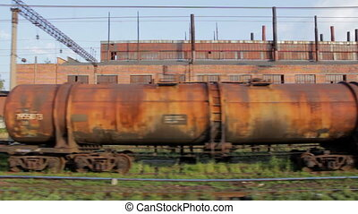 Old rusty cargo train (Full HD), view from another train...