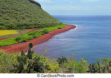 View of red beach and lagoon of Rabida Island in Galapagos...