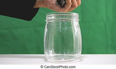 HD Falling of coins to glass jar concept to saving money with copyspace