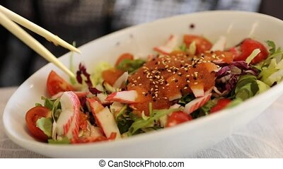 Salad of sashimi and shrimp with tomatoes and smoked salmon....