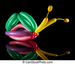 Multi-colored balloon snail isolated on black