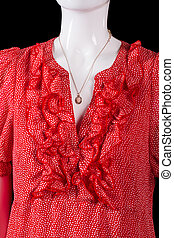 Red v-neck dress and pendant. Small necklace on white...