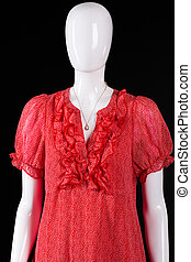 Red v-neck dress and necklace. White mannequin wearing small...