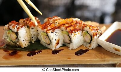 Uramaki of shrimp tempura, cheese, avocado and tobiko caviar...