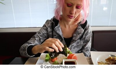 Woman eating Temaki Cone - Glamour woman eating in slow...