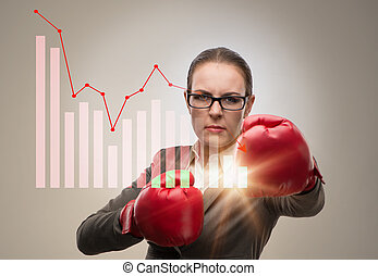 Businesswoman in competition concept with boxing