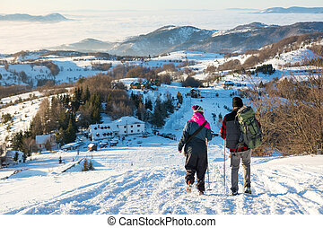 Couple of hikers walking down the hill