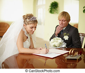 Registration of marriage. Groom in doubt. - The official...