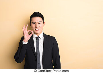 man give you a gesture of okay - young Asian business man...