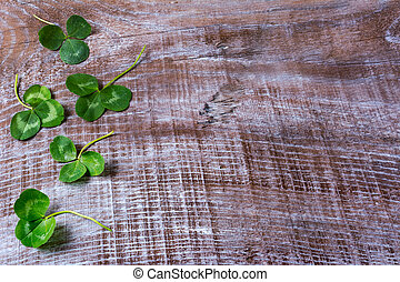 St. Patricks day greeting with clovers leaves frame on...