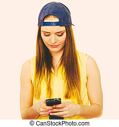 Young woman using cell phone.