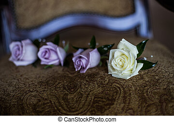 Groom's boutonnieres roses white and purple