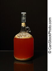 Fermenting Homebrew Beer - A one gallon growler used for...