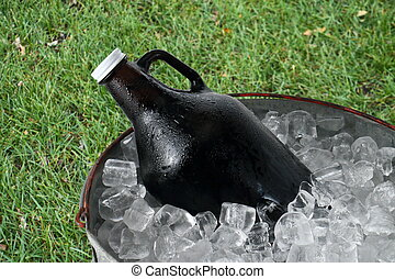 Beer Growler in Ice Bucket - A 64 ounce beer growler in a...