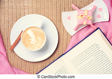 Coffee with pink scarf. Valentines concept. Rustic style....