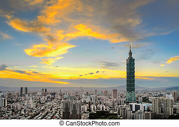 City skyline with dramatic clouds and famous skyscraper in...