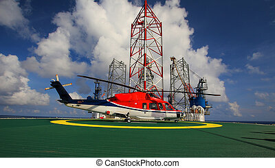 working offshore,The helicopter landed on the rig, sea, changing the working group, working on the rig at sea, to return home.The helicopter on the drilling rig