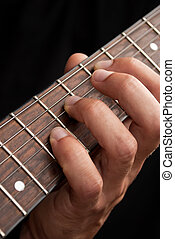 Guitar and hand - Hand on guitar fretboard close up