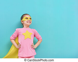 child plays superhero - Little child plays superhero. Kid on...