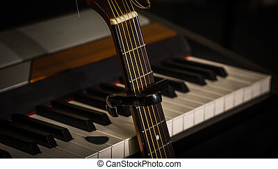 musical instruments piano keys and acoustic guitar...