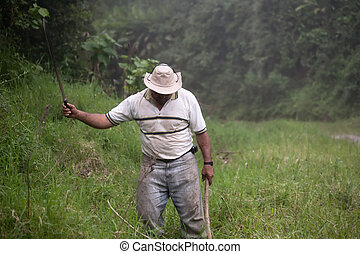 Costa Rican ranch hand with a machete
