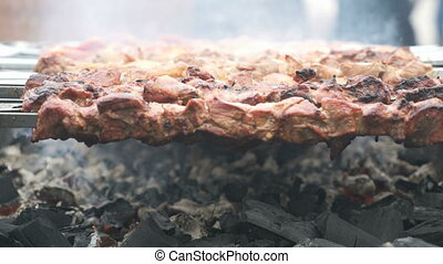 Cooking of beef kebabs on the brazier