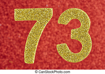 Number seventy-three yellow color over a red background....
