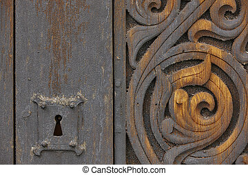 Norwegian ancient wooden carved door with lock. Heddal...