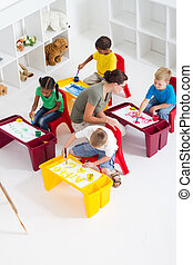 preschool students and teacher - overhead view of preschool...
