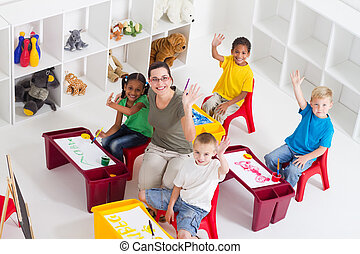 preschool teacher and kids - overhead view of group of...