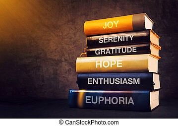 Positive emotions and feelings concept with book titles on...