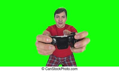Emotional gamer on the gamepad. Green screen - Emotions on...