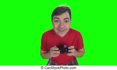 Emotions on the gamer face while playing on the gamepad,...