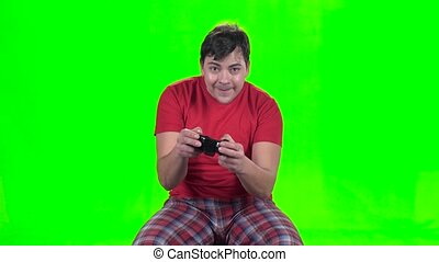 Funny man playing on the gamepad in new video game