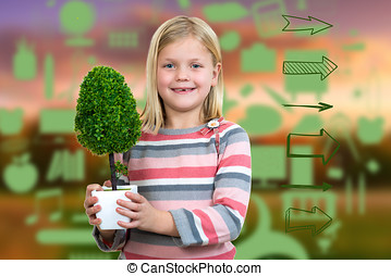 little girl holding a plant. white background
