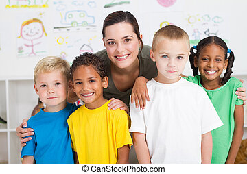 kids and teacher - group of preschool kids and teacher in...