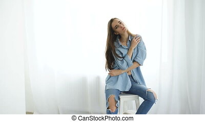 Professional fashion model posing and looking into camera....