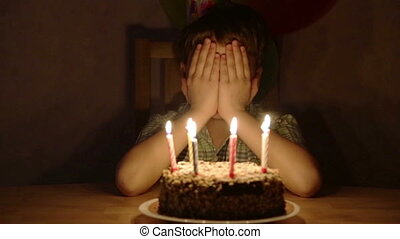 Boy blowing the candles on birthday cake - Boy blowing the...