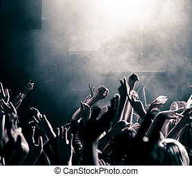 Concert crowd with hands up, toned