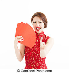 happy woman wear cheongsam and showing thumb up