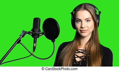 Woman listening to the music in headphones - Audio recording...