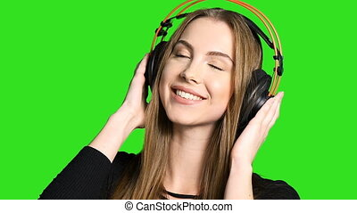 Woman listening to the music in headphones - Closeup of...